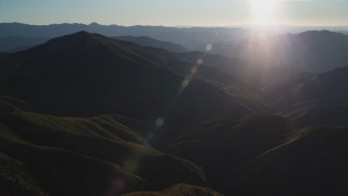 DFKSF17_015 - 5K stock footage aerial video flyby mountains with sun in the distance, San Luis Obispo County, California