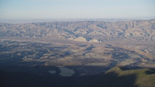 DFKSF17_020 - 5K stock footage aerial video of flying by Cuyama Valley and Caliente Mountain Range, San Luis Obispo, California