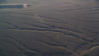 DFKSF17_022 - 5K stock footage aerial video of flying by deep cracks in the desert, Cuyama Valley, California