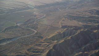 DFKSF17_025 - 5K stock footage aerial video of flying by a dry riverbed and Caliente Range mountains, Cuyama Valley, California