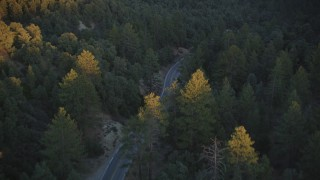 DFKSF17_046 - 5K stock footage aerial video of following a road through the forest, Los Padres National Forest, California, sunset