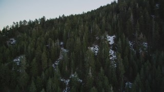 DFKSF17_051 - 5K stock footage aerial video of flying over patches of snow and mountain in the Los Padres National Forest, California, twilight