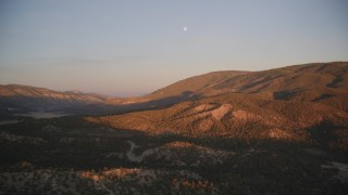 DFKSF17_054 - 5K stock footage aerial video of flying by mountains with moon above, Los Padres National Forest, California, sunset