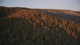 DFKSF17_056 - 5K stock footage aerial video of flying by wooded mountain ridge, Los Padres National Forest, California, sunset