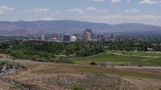 DX0001_000004 - 5.7K stock footage aerial video of a view of the city skyline from a park in Reno, Nevada