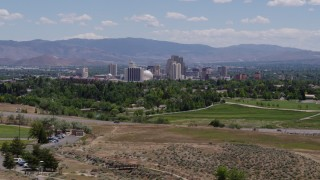 DX0001_000005 - 5.7K stock footage aerial video of a view of the city skyline from a park and freeway in Reno, Nevada