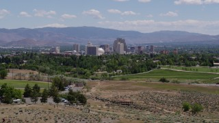 DX0001_000006 - 5.7K stock footage aerial video of a view of the distant city skyline from a park in Reno, Nevada
