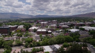 DX0001_000017 - 5.7K stock footage aerial video a reverse view of buildings on the campus of the University of Nevada in Reno, Nevada