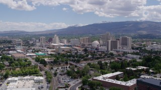 DX0001_000031 - 5.7K stock footage aerial video of a view of hotels and casinos of the city's skyline while descending in Reno, Nevada