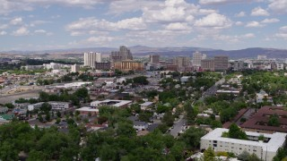 DX0001_000046 - 5.7K stock footage aerial video of a reverse view of hotels and casinos of the city's skyline in Reno, Nevada