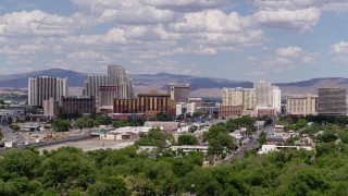 DX0001_000055 - 5.7K stock footage aerial video of a view of the large hotels and casino resorts of Reno, Nevada seen while ascending