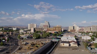 DX0001_000063 - 5.7K stock footage aerial video of a reverse view of train tracks leading to casino resorts in Reno, Nevada