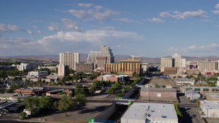 DX0001_000067 - 5.7K stock footage aerial video of flying away from train tracks and the city skyline in Reno, Nevada