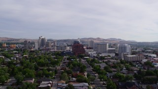 DX0001_000093 - 5.7K stock footage aerial video fly away from casino resorts and office buildings in Reno, Nevada