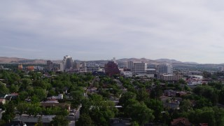 DX0001_000094 - 5.7K stock footage aerial video descending from a view of casino resorts and office buildings in Reno, Nevada