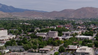 DX0001_000111 - 5.7K stock footage aerial video flyby the Nevada State Capitol dome and other government buildings in Carson City, Nevada