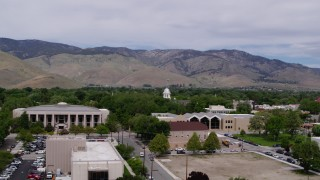 DX0001_000124 - 5.7K stock footage aerial video approach the Supreme Court, the Nevada State Capitol, and State Library in Carson City, Nevada