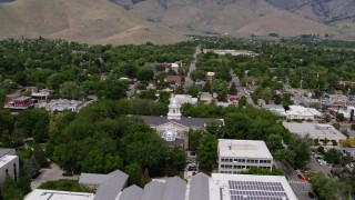 DX0001_000126 - 5.7K stock footage aerial video of reverse view of the Nevada State Capitol, State Library, and reveal Supreme Court in Carson City, Nevada