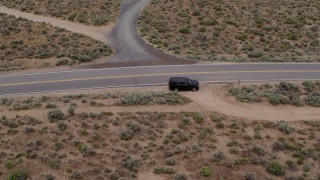 DX0001_000131 - 5.7K stock footage aerial video track a black SUV as it turns and drives in the opposite direction in Carson City, Nevada
