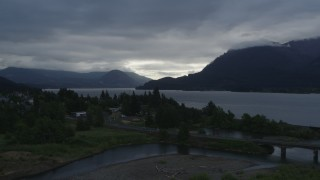DX0001_000143 - 5.7K stock footage aerial video of the Columbia River and cloud-shrouded mountains at sunrise, Stevenson, Washington