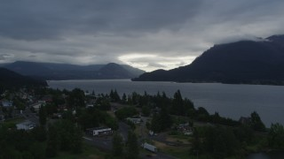DX0001_000144 - 5.7K stock footage aerial video approach the Columbia River and cloud-shrouded mountains at sunrise, Stevenson, Washington