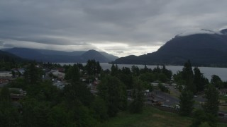 DX0001_000146 - 5.7K stock footage aerial video of bridges spanning creek, and mountains across the Columbia River at sunrise, Stevenson, Washington