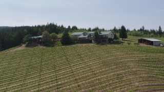 DX0001_000163 - 5.7K stock footage aerial video of flying over Phelps Creek Vineyards toward a hilltop home in Hood River, Oregon