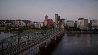 DX0001_000165 - 4K stock footage aerial video of Hawthorne Bridge spanning the Willamette River at sunrise, Downtown Portland, Oregon