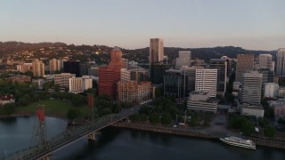DX0001_000175 - 4K stock footage aerial video flying away from downtown by Hawthorne Bridge, Downtown Portland, Oregon