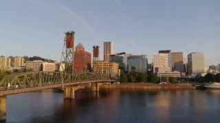 DX0001_000187 - 4K stock footage aerial video flying over Hawthorne Bridge, approaching waterfront park and Downtown Portland, Oregon at sunrise