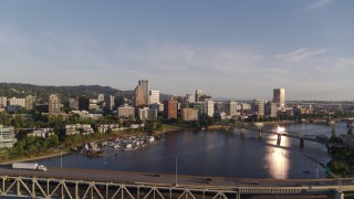 DX0001_000197 - 4K stock footage aerial video flying away from Riverplace Marina and over Marquam Bridge, Downtown Portland, Oregon