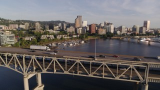 DX0001_000199 - 4K stock footage aerial video tracking traffic on Marquam Bridge spanning Willamette River, Downtown Portland, Oregon