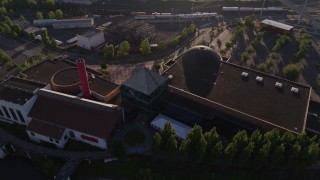 DX0001_000210 - 5.7K stock footage aerial video orbiting OMSI, revealing Marquam Bridge, Willamette River, Southeast Portland, Oregon