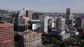 DX0001_000217 - 5.7K stock footage aerial video approaching skyscrapers and an office building under construction, Downtown Portland, Oregon