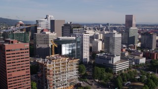 DX0001_000218 - 5.7K stock footage aerial video flying away from downtown buildings, skyscrapers and construction crane, Downtown Portland, Oregon