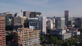 DX0001_000220 - 5.7K stock footage aerial video flying over Willamette River, approaching downtown buildings, Downtown Portland, Oregon