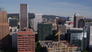 DX0001_000225 - 5.7K stock footage aerial video flying closely by office buildings and skyscrapers, Downtown Portland, Oregon