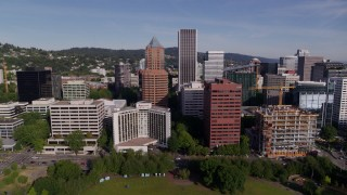 DX0001_000235 - 5.7K stock footage aerial video flying away from downtown buildings and the waterfront park in Downtown Portland, Oregon