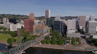 DX0001_000237 - 5.7K stock footage aerial video approaching office buildings and KOIN Center from the river in Downtown Portland, Oregon