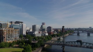 DX0001_000240 - 5.7K stock footage aerial video flying away from office buildings revealing Hawthorne Bridge, Downtown Portland, Oregon
