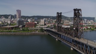 DX0001_000246 - 5.7K stock footage aerial video flying by Steel Bridge and revealing waterfront apartment buildings, Downtown Portland, Oregon