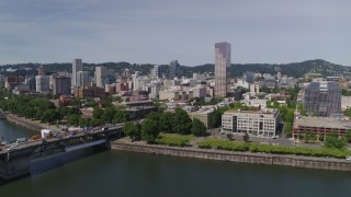 DX0001_000249 - 5.7K stock footage aerial video of Burnside Bridge and the iconic White Stag building and sign, Downtown Portland, Oregon