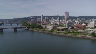 DX0001_000255 - 5.7K stock footage aerial video descending to stationary over Willamette River, looking toward Downtown  Portland, Oregon