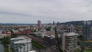 DX0001_000260 - 5.7K stock footage aerial video of distant skyscrapers seen from the train station and condominiums, Downtown Portland, Oregon