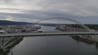 DX0001_000270 - 5.7K stock footage aerial video of heavy traffic on Fremont Bridge, sunset, Portland, Oregon