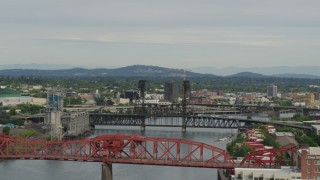 DX0001_000272 - 5.7K stock footage aerial video panning from Broadway Bridge to Downtown Portland, sunset, Oregon