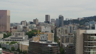DX0001_000275 - 5.7K stock footage aerial video reverse from Downtown Portland skyscrapers at sunset and descend by condos, Oregon