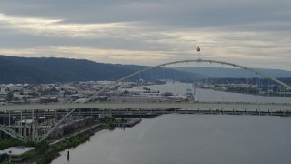 DX0001_000280 - 5.7K stock footage aerial video of Fremont Bridge with traffic crossing the span, sunset, Downtown Portland, Oregon