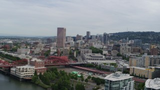 DX0001_000283 - 5.7K stock footage aerial video of a reverse view of Downtown Portland, Oregon at sunset, revealing condominiums