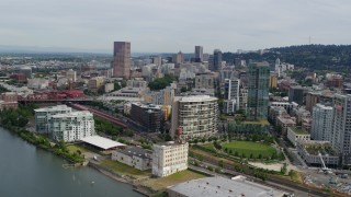DX0001_000284 - 5.7K stock footage aerial video of downtown buildings, waterfront condominiums and a park, sunset, Downtown Portland, Oregon